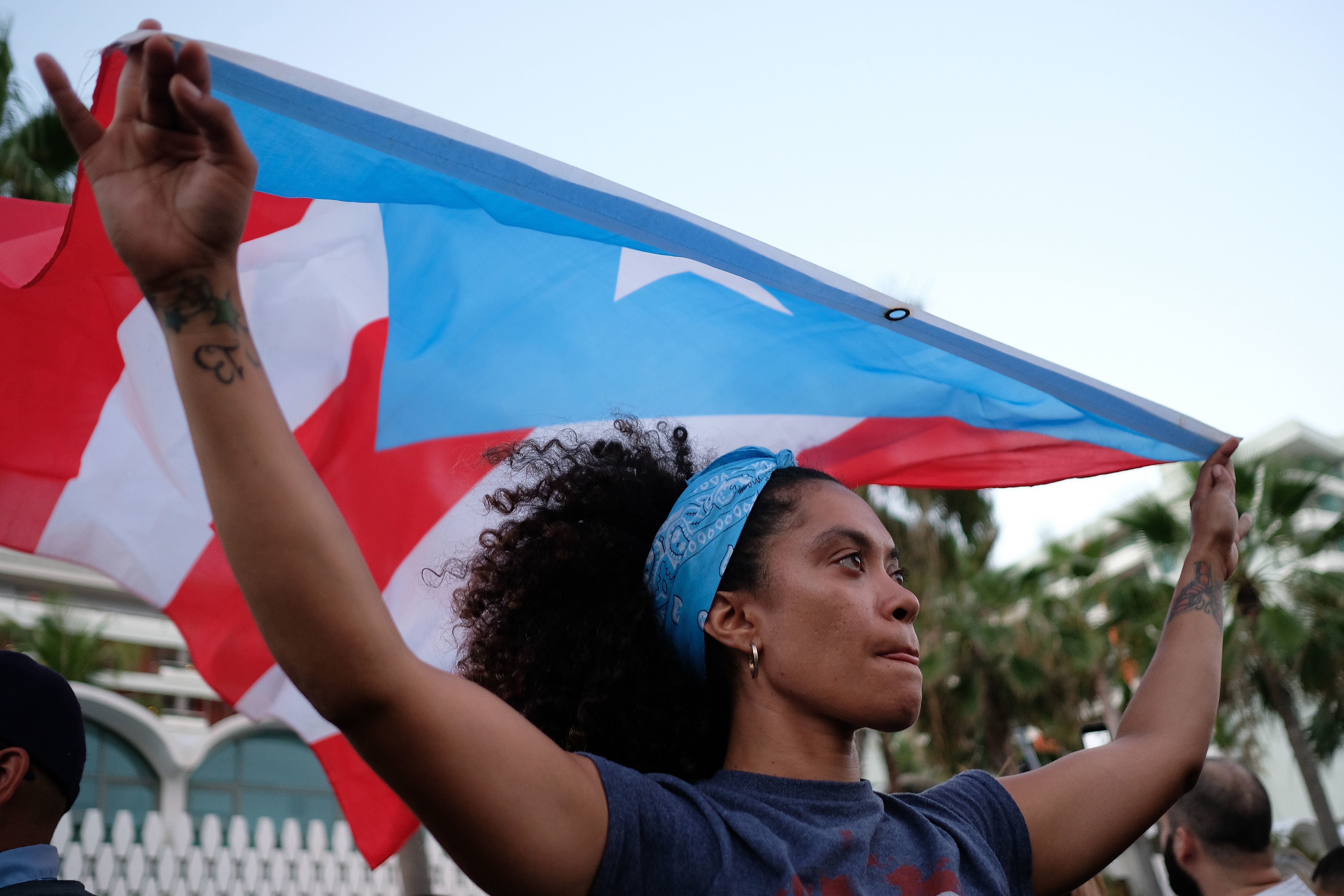 People march to protest pension cuts, school closures and slow hurricane recovery efforts in the El Condado tourist zone in San Juan, Puerto Rico, Tuesday, May 2, 2018. (Photo by Ricardo ARDUENGO / AFP)        (Photo credit should read RICARDO ARDUENGO/AFP/Getty Images)
