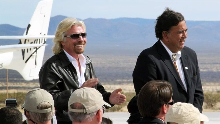 Virgin Galactic founder Richard Branson, left, and former New Mexico Gov. Bill Richardson, a Democrat, stand together at a ru