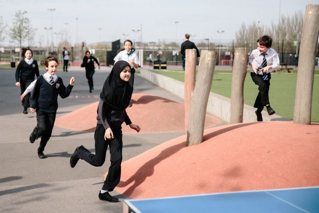 Children at Chobham Academy, London, taking part in a 'Marathon Kids' session.