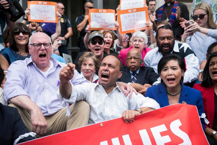 Rep. Joe Crowley (D-N.Y.), left, and other congressional Democrats, participate in a protest in Washington against the Trump