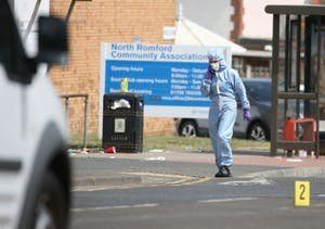 Forensic investigators at the scene in Romford, east London