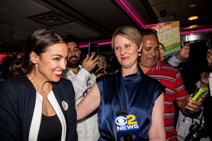 Alexandria Ocasio-Cortez celebrates her surprise victory Tuesday night with New York gubernatorial candidate Cynthia Nixon.