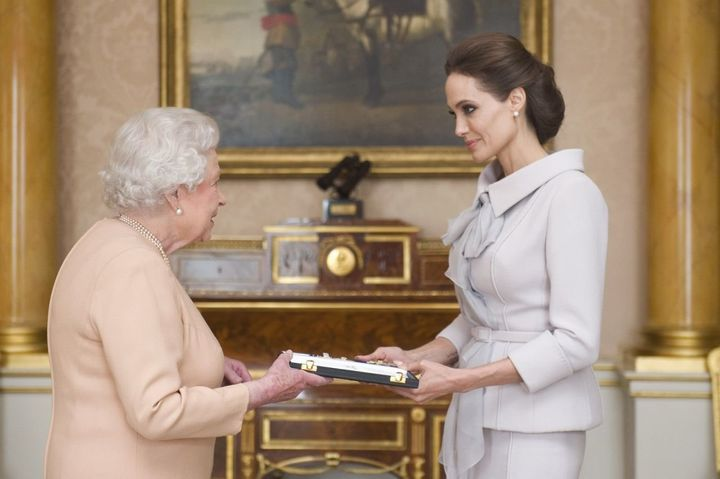 Angelina Jolie wore the cross given to her by the queen in 2014.