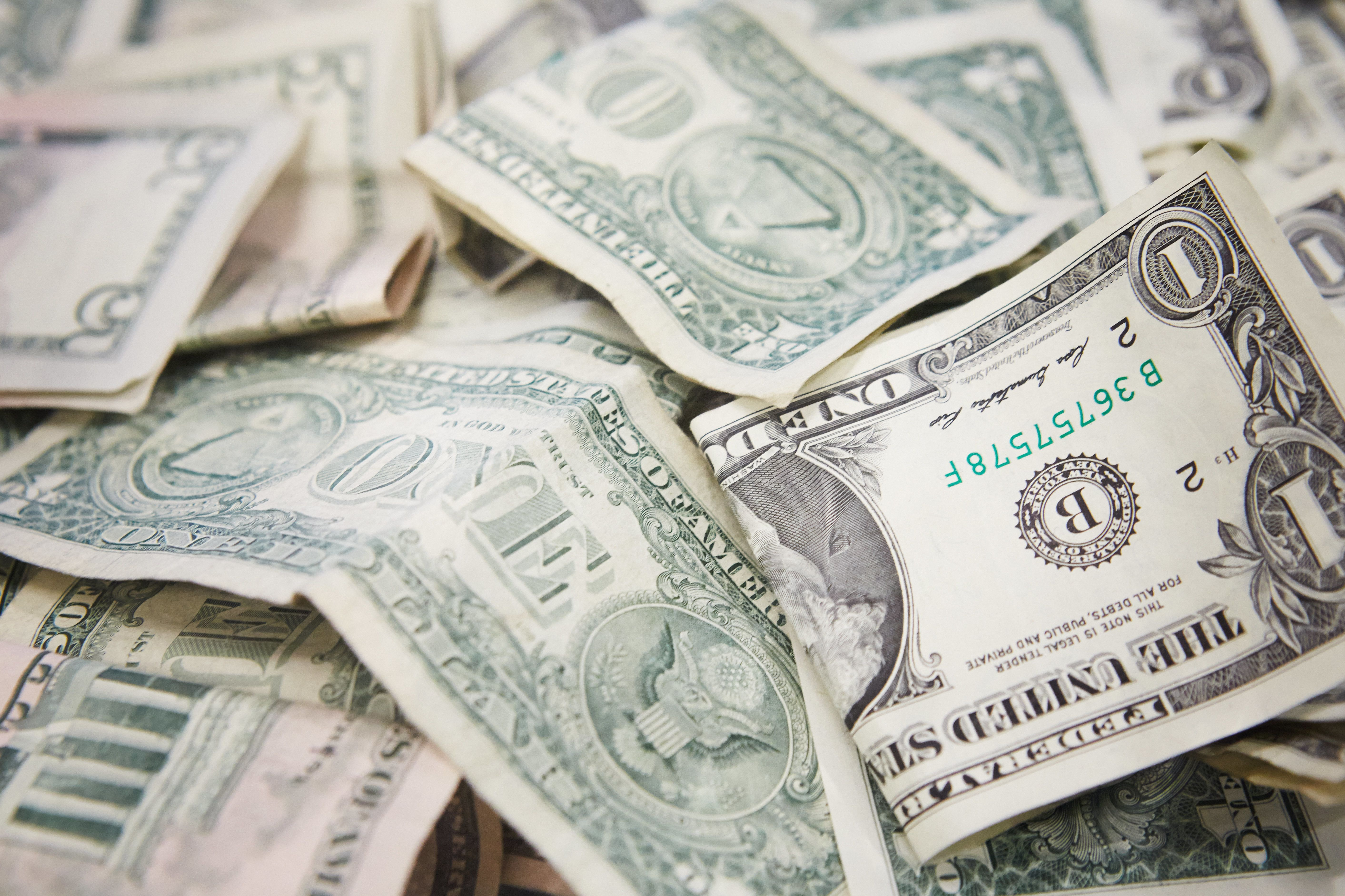 hundreds of one dollar banknotes, america