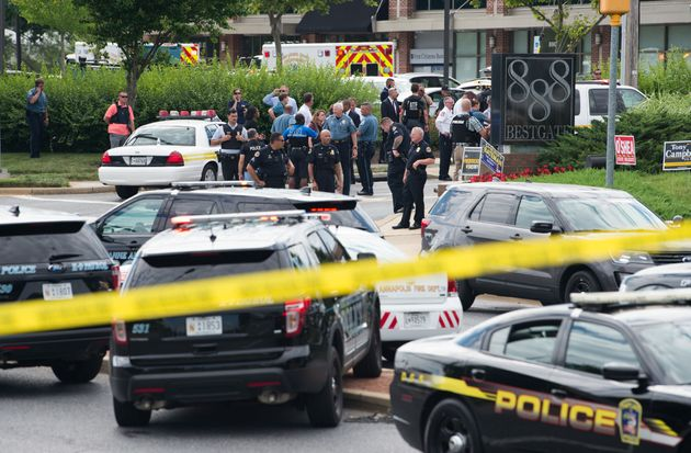 Police respond to a shooting at the office building that houses the Capital Gazette newsroom in Annapolis,...