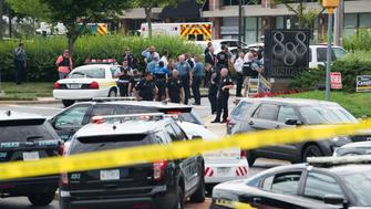 Police respond to a shooting in Annapolis, Maryland, June 28, 2018. - Several people were feared killed Thursday in a shooting at the building that houses the Capital Gazette, a daily newspaper published in Annapolis, a historic city an hour east of Washington. A reporter for the Capital Gazette, Phil Davis, tweeted that a 'gunman shot through the glass door to the office and opened fire on multiple employees.' He said several people were killed.'There is nothing more terrifying than hearing multiple people get shot while you're under your desk and then hear the gunman reload,' Davis said. (Photo by SAUL LOEB / AFP)        (Photo credit should read SAUL LOEB/AFP/Getty Images)