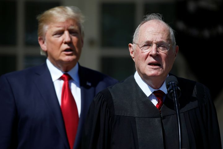 President Donald Trump listens as Justice Anthony Kennedy speaks before swearing in Neil Gorsuch to the Supreme Court in Apri