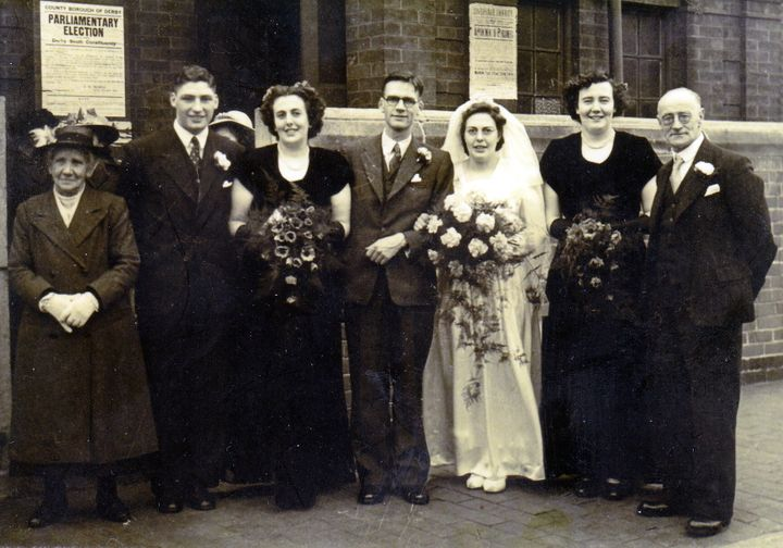 Eric and Edith with friends and family on their wedding day.