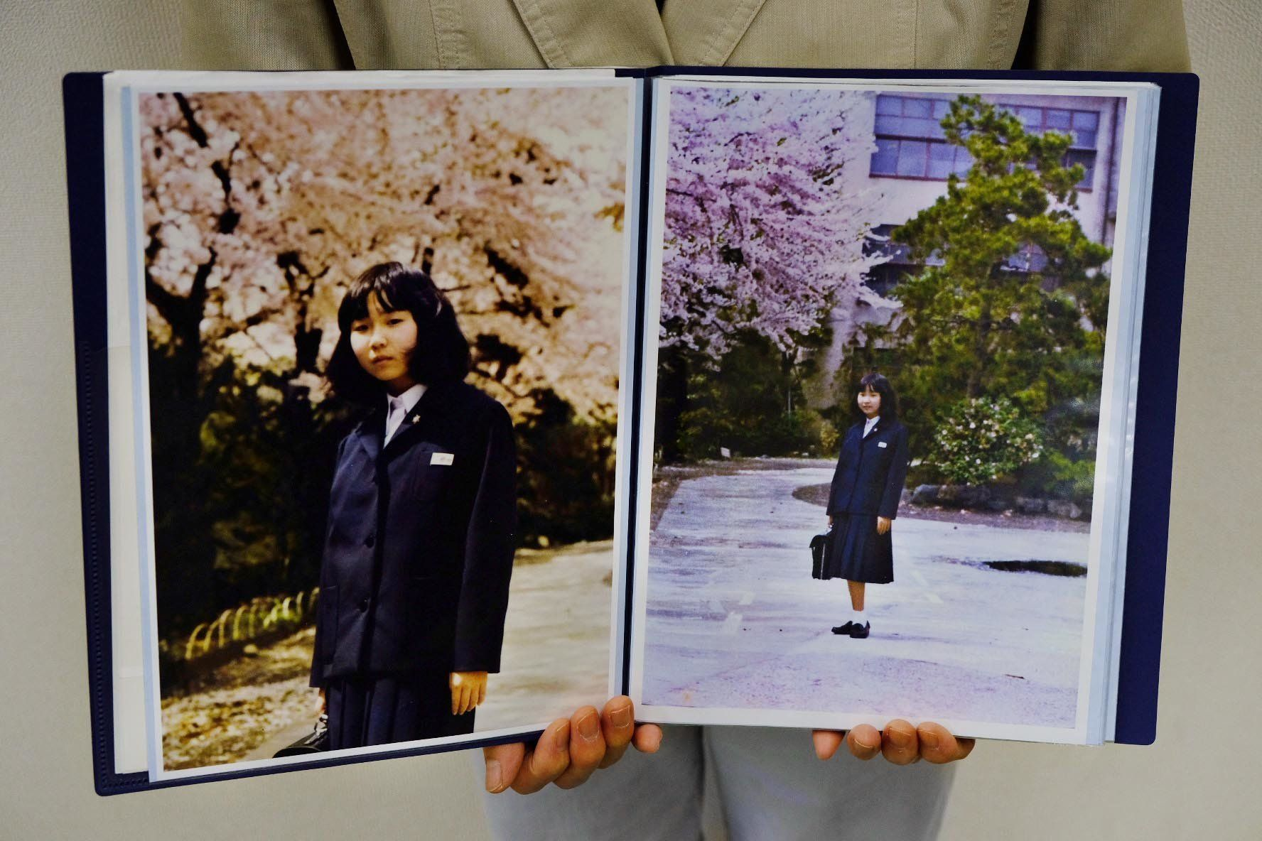 Sakie Yokota holds up a photo of her 13-year-old daughter Megumi, whom North Korea kidnapped in 1977.