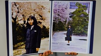Sakie Yokota holds up a photo of her 13-year-old daughter Megumi who North Korea kidnapped in 1977