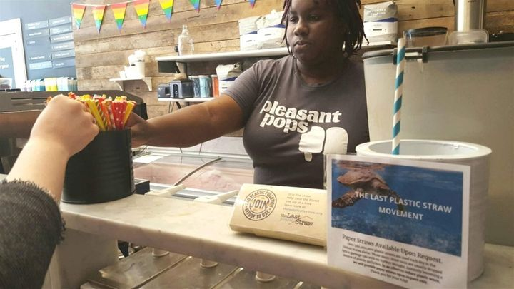 Nadia Bartholomew, a worker at Pleasant Pops coffee and treats shop in Washington, D.C., offers a customer a selection of pap