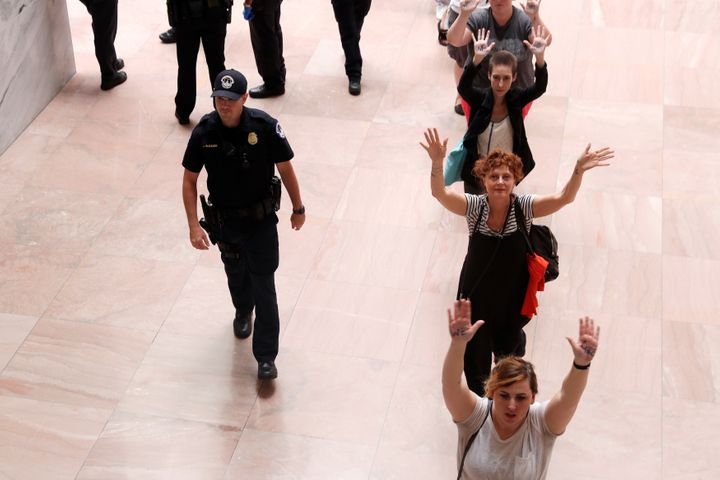 Sarandon walks to be arrested as she joined demonstrators in an anti-Trump immigration policy protest on June 28, 2018.