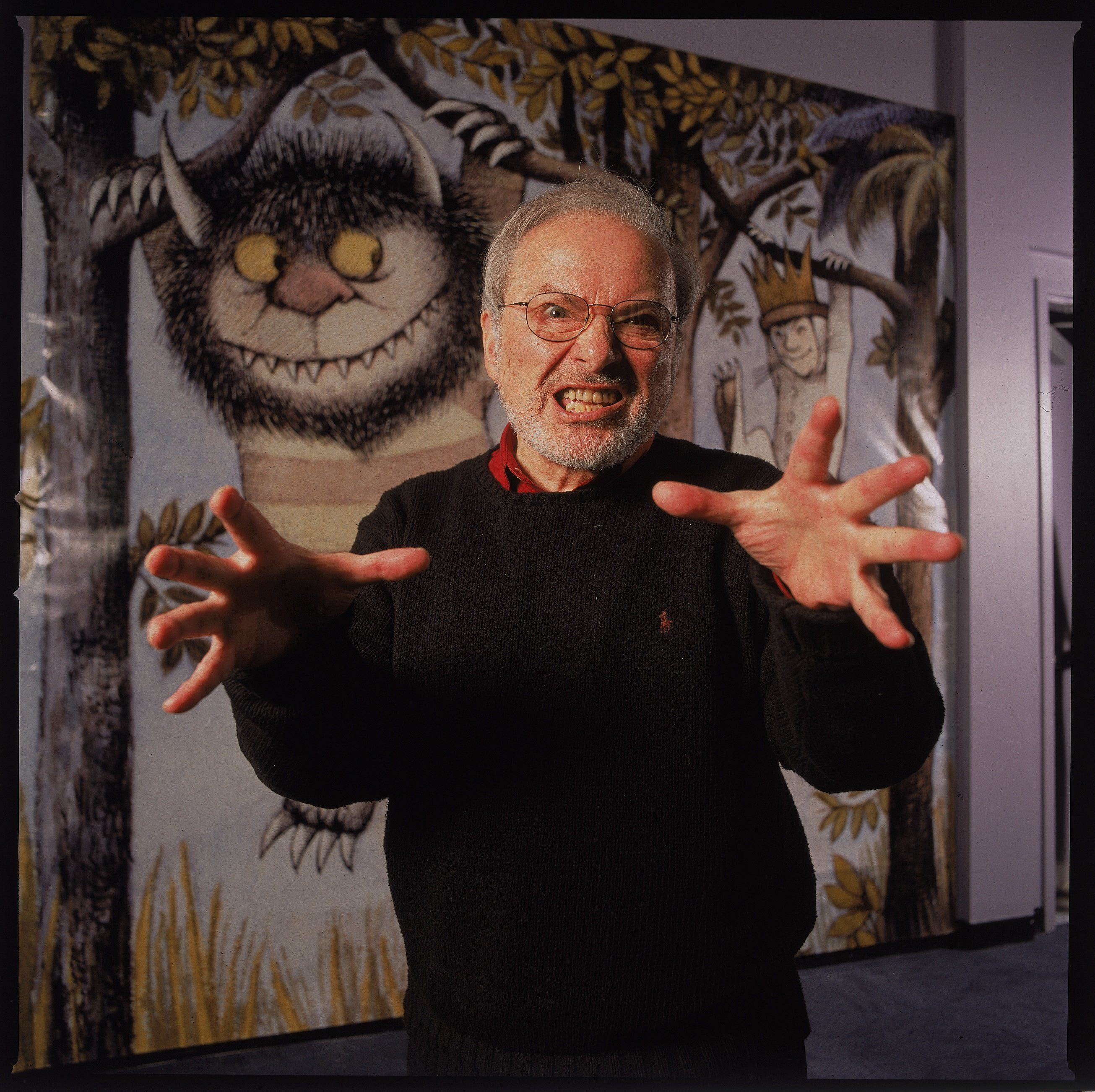 NEW YORK, UNITED STATES - JANUARY 11:  Author/illustrator Maurice Sendak standing by an life-size scene from his book WHERE THE WILD THINGS ARE at the Children's Museum of Manhattan which is honoring his 50 years of work with an exhibit.  (Photo by James