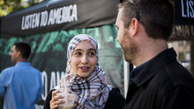 """DETROIT, MI - OCTOBER 3: Rowaida Abdelaziz speaks with Chris Mathias during HuffPost's visit to Detroit, Michigan, on Oct. 3, 2017, as part of """"Listen To America: A HuffPost Road Trip."""" The outlet will visit more than 20 cities on its tour across the country. (Photo by Damon Dahlen/HuffPost) *** Local Caption ***"""