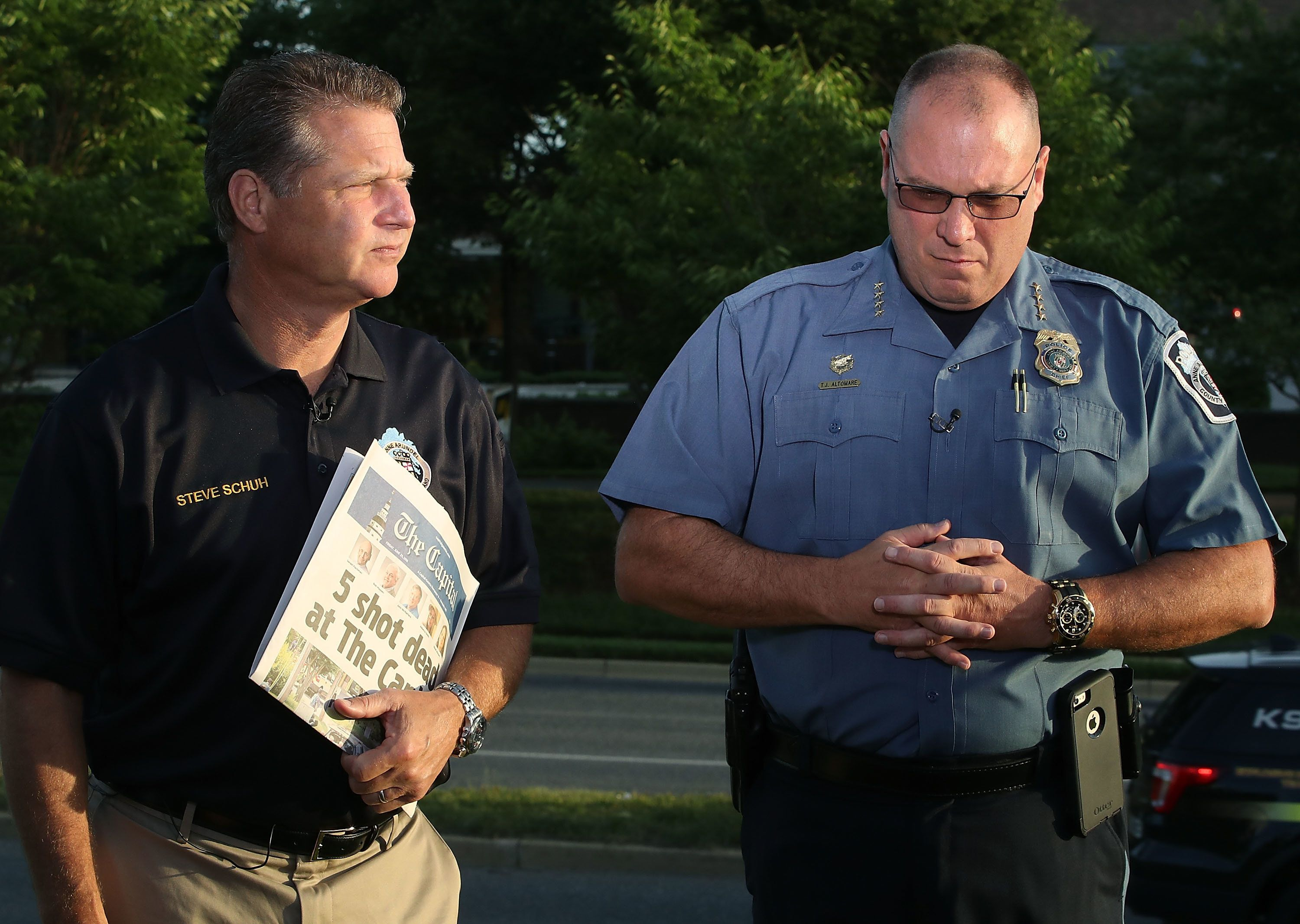 ANNAPOLIS, MD - JUNE 29: Anne Arundel County Executive Steven Schuh (L), and Anne Arundel County Police Chief Tim Altomare, give a television interview near the Capital Gazette where 5 people were shot and killed by a gunman on Thursday, on June 289, 2018 in Annapolis, Maryland. Jarrod Ramos of Laurel Md. has been arrested and charged with killing 5 people at the daily newspaper.  (Photo by Mark Wilson/Getty Images)