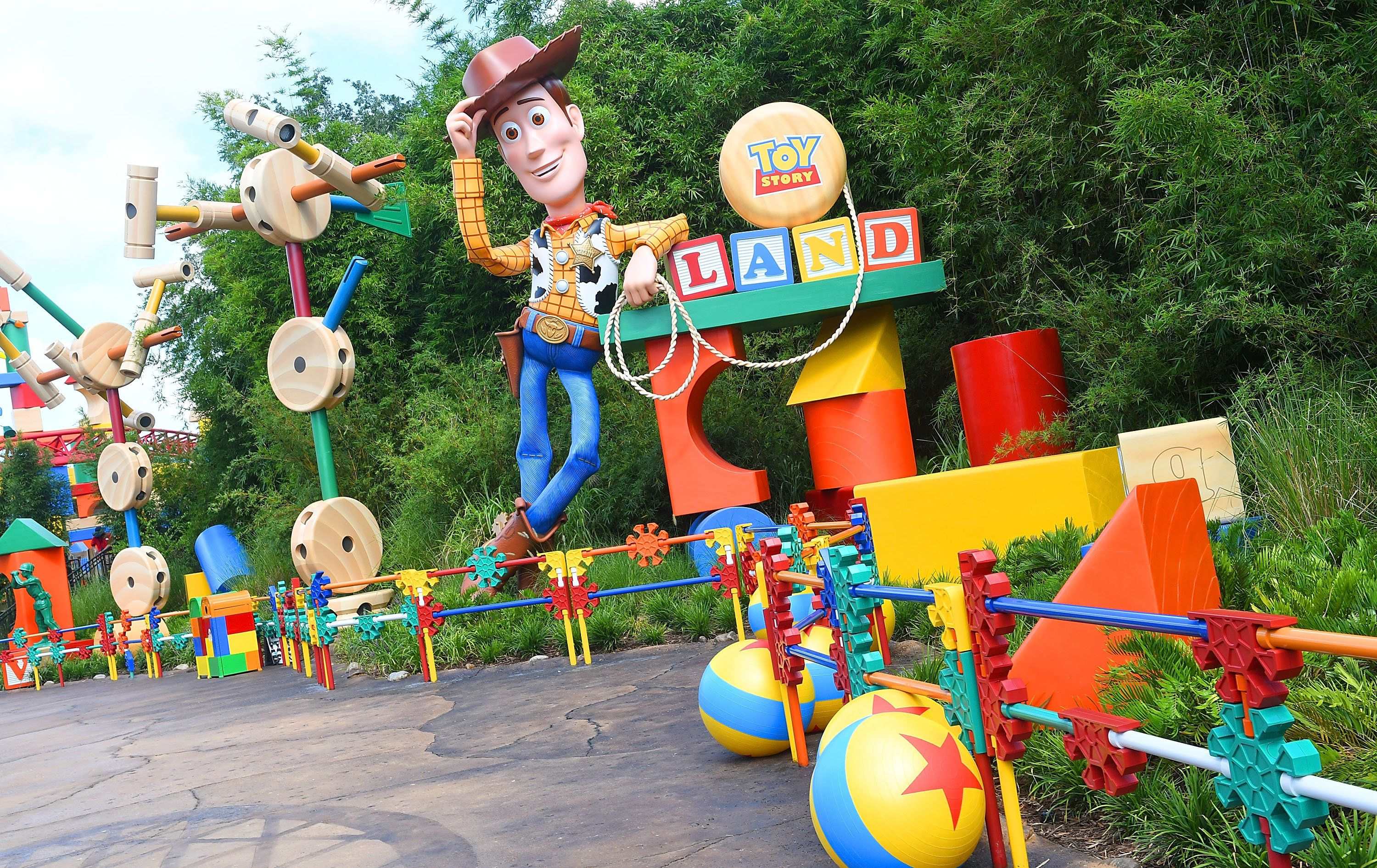 Woody welcomes fans to Toy Story Land, which is full of details from the movies. For example, the yellow ball with a blue str