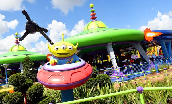 """During the ride, the green aliens (pictured here) try to get captured by """"the claw."""""""