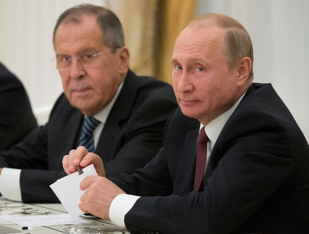Russian Foreign Minister Sergei Lavrov, pictured left, with President Vladimir Putin in June 2018