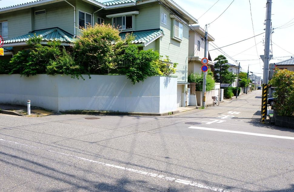 This is the intersection where police dogs lost Megumi Yokota's trail. A short walk down the alleyway is the Yokotas' former