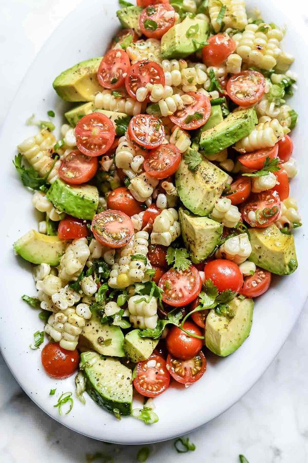 "<strong>Get the <a href=""https://www.foodiecrush.com/grilled-corn-tomato-avocado-salad/"" target=""_blank"">Grilled Corn Sa"