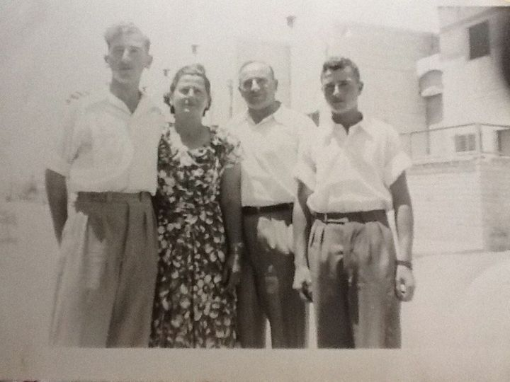 Mordechai, left, as a teen in Israel with his parents and younger brother.