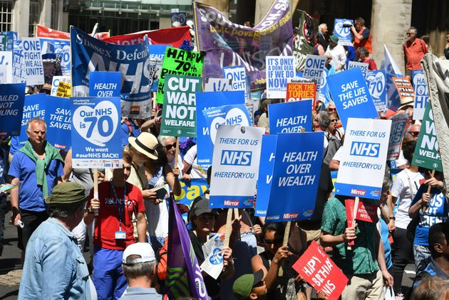 People march in central London to mark the 70th anniversary of the NHS.
