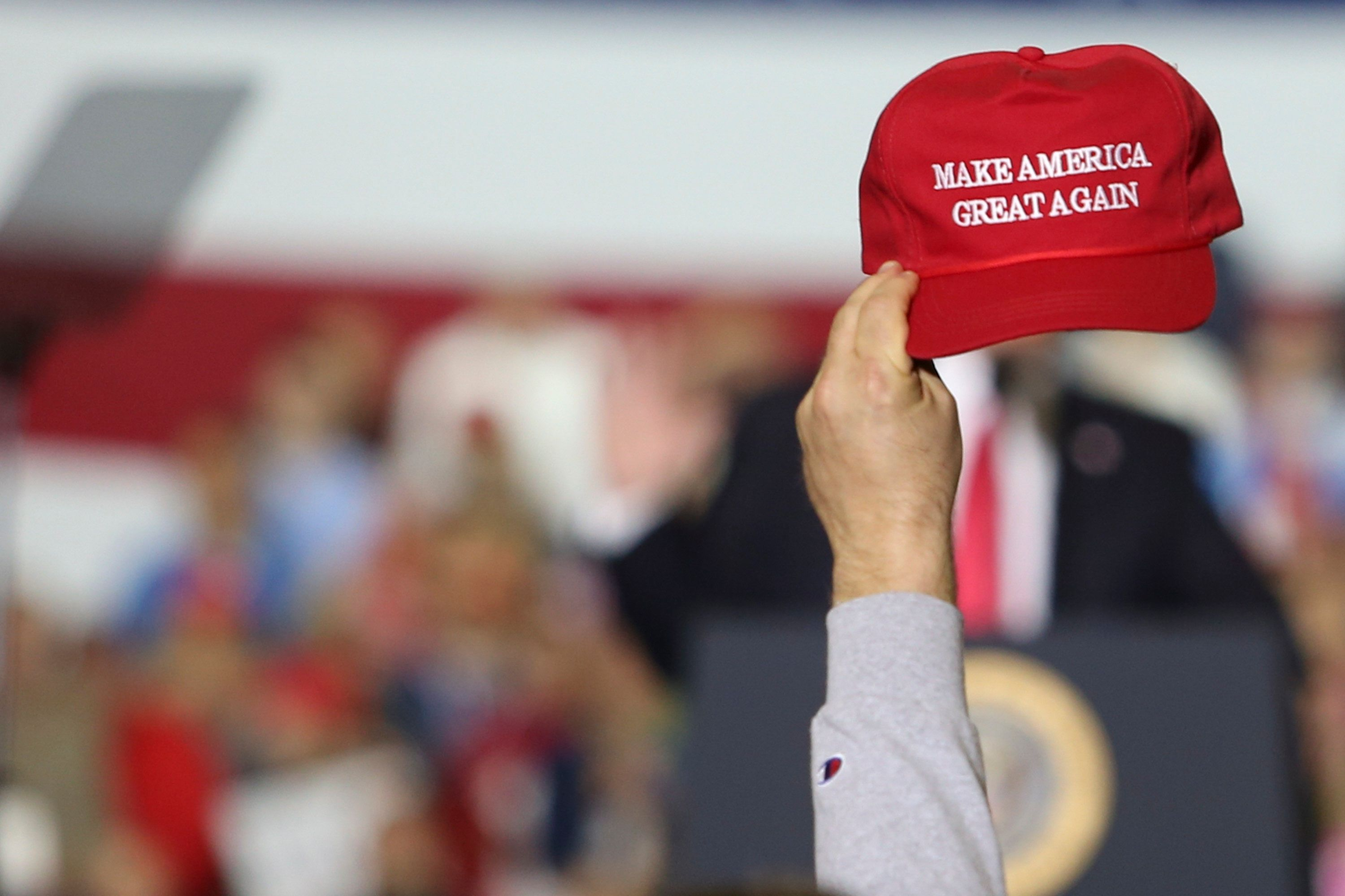 TOTAL SPORTS, WASHINGTON TOWNSHIP, MICHIGAN, UNITED STATES - 2018/04/28: A supporter seen raising a caps writting on it 'Make America Great Again' while the President Donald Trump gives a speech during a campaign rally in Washingtown Township, Michigan. (Photo by Chirag Wakaskar/SOPA Images/LightRocket via Getty Images)