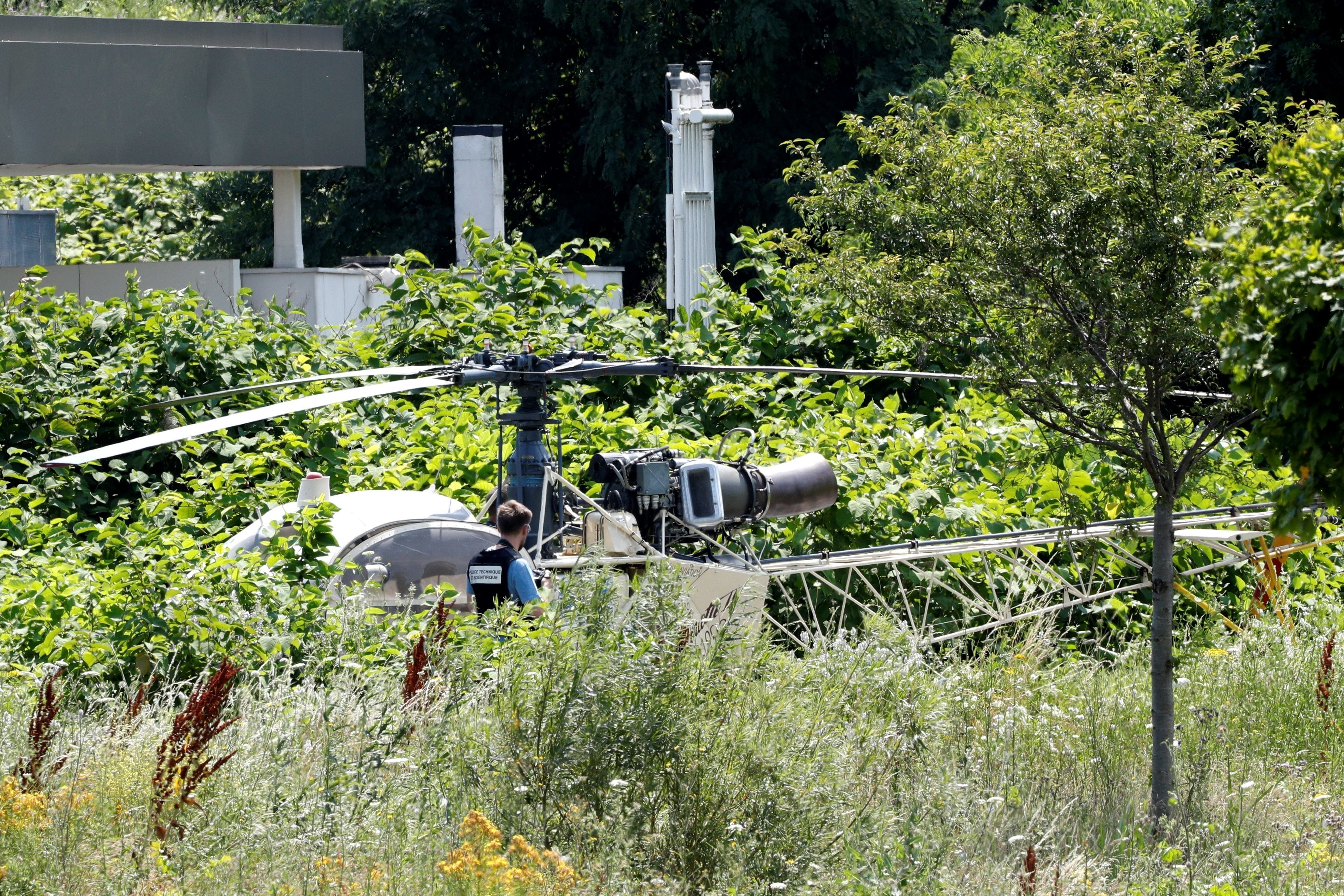 AFrench helicopter that was abandoned by French armed robber Redoine Faid is seen in Reau, southeast of Paris, on Sunda