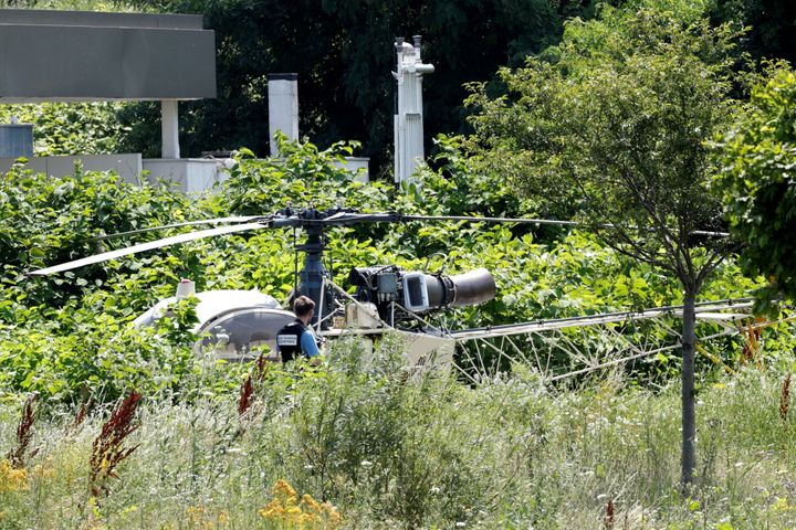 A French helicopter that was abandoned by French armed robber Redoine Faid is seen in Reau, southeast of Paris, on Sunda