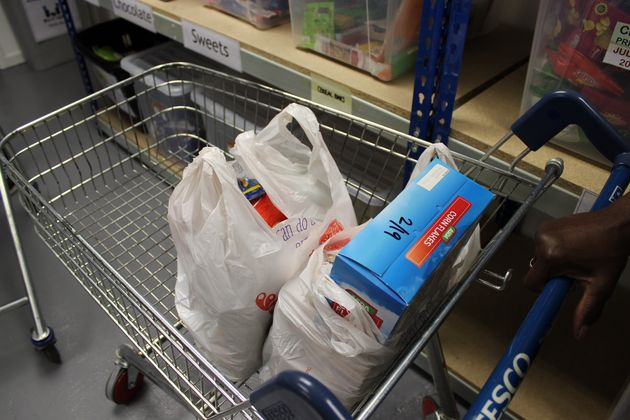 Items are placed into bags from the same supermarket to keep food donations
