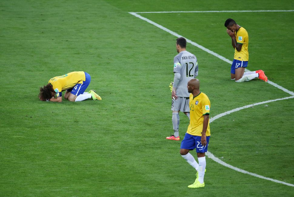 Brazilian players on the field in Belo Horizonte after the national team's devastating 7-1 loss to Germany in the 2014 World