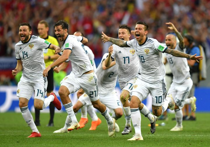 Russia players celebrate following their victory in a penalty shootout during the 2018 FIFA World Cup Russia Round of 16 matc