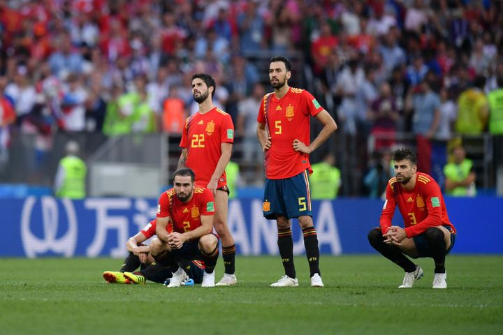 Spain players look dejected during a penalty shoot out against Russia on Sunday.