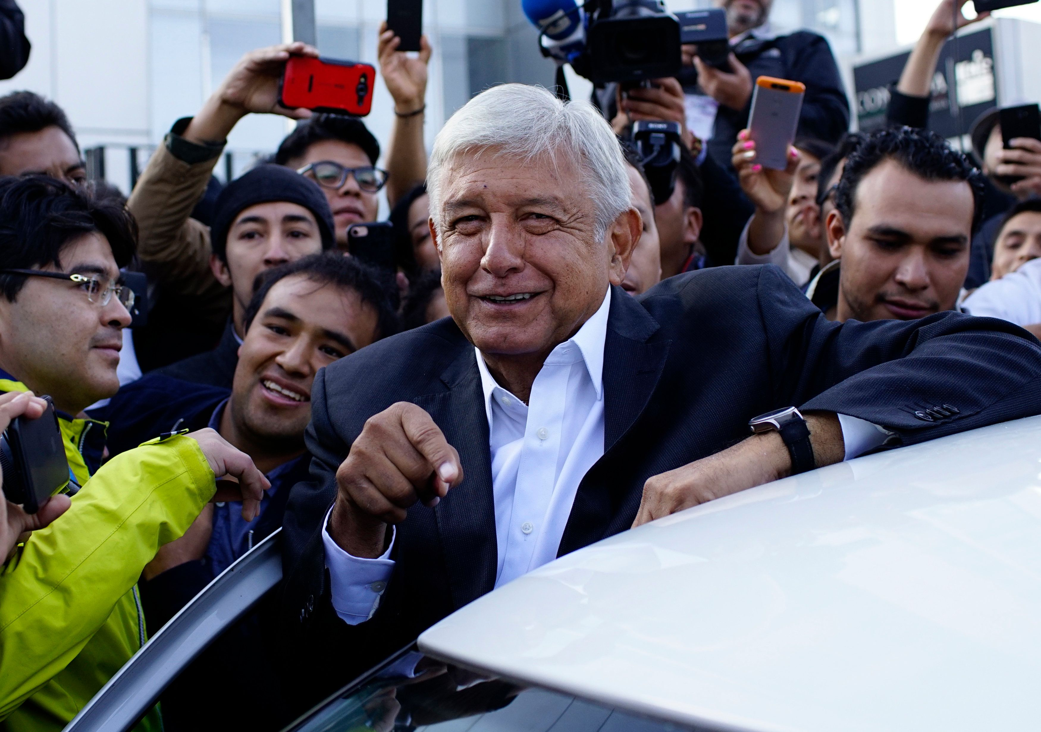 Presidential candidate Andres Manuel Lopez Obrador talks to reporters as he departs after casting his ballot at a polling station during the presidential election in Mexico City, Mexico, July 1, 2018. REUTERS/Alexandre Meneghini