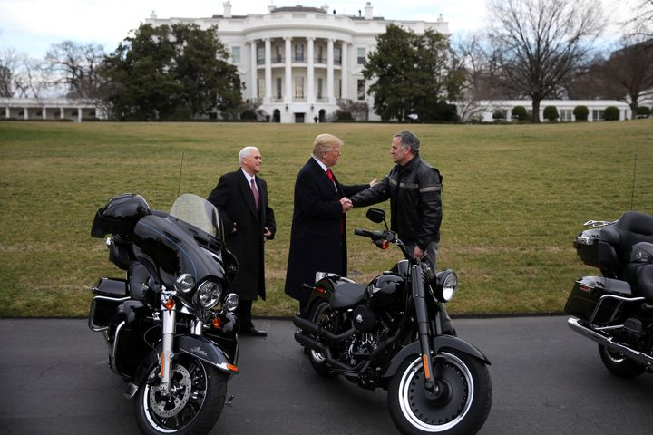 U.S. President Donald Trump shakes hands with Matthew S Levatich, CEO of Harley Davidson, accompanied by Vice President Mike