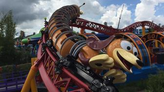 The Slinky Dog Dash coaster rushes down the tracks