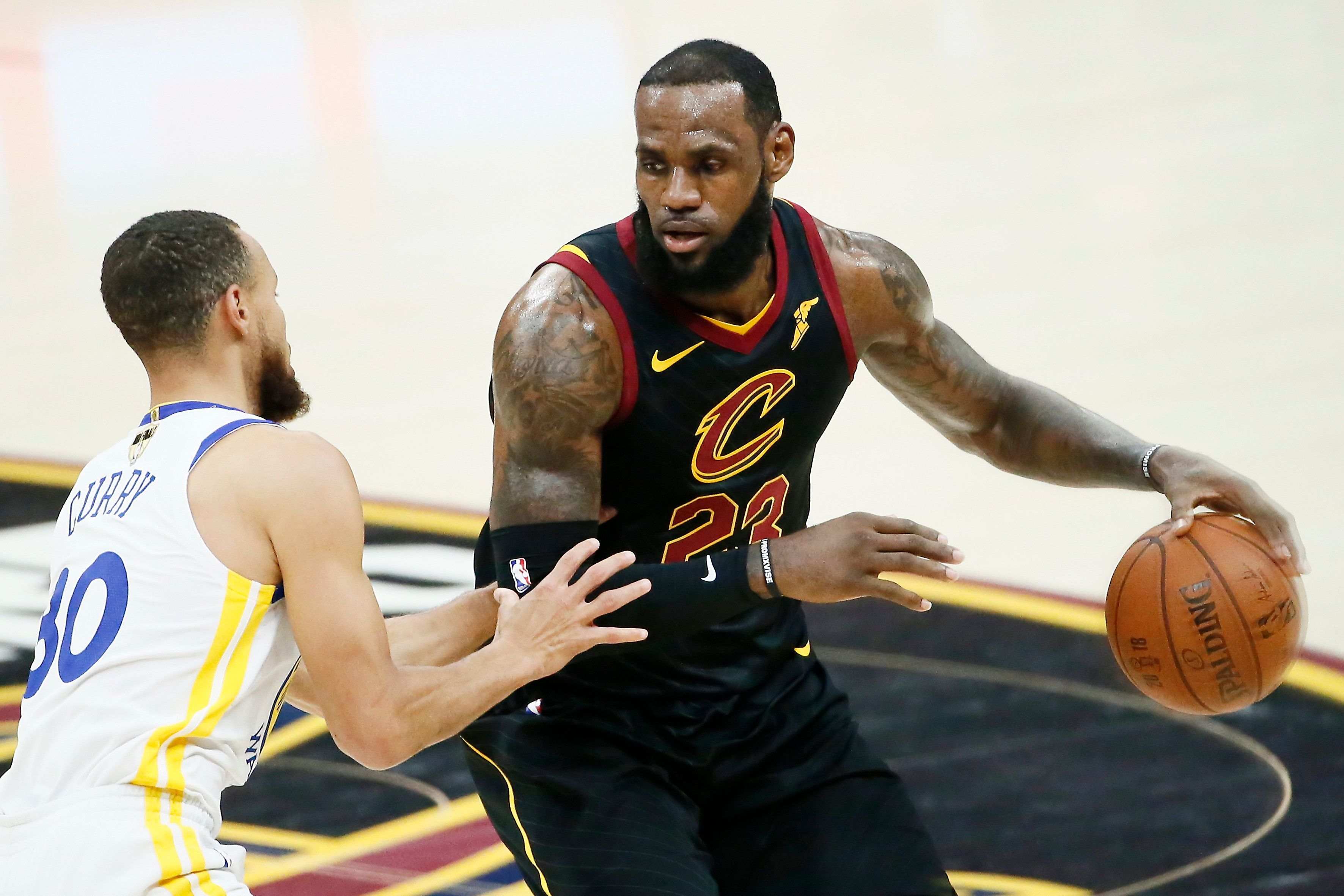 CLEVELAND, CA - JUN 8:  LeBron James #23 of the Cleveland Cavaliers handles the ball against Stephen Curry #30 of the Golden State Warriors in Game Four of the 2018 NBA Finals won 108-85 by the Golden State Warriors over the Cleveland Cavaliers at the Quicken Loans Arena on June 6, 2018 in Cleveland, Ohio. NOTE TO USER: User expressly acknowledges and agrees that, by downloading and or using this photograph, User is consenting to the terms and conditions of the Getty Images License Agreement. Mandatory Copyright Notice: Copyright 2018 NBAE (Photo by Chris Elise/NBAE via Getty Images)