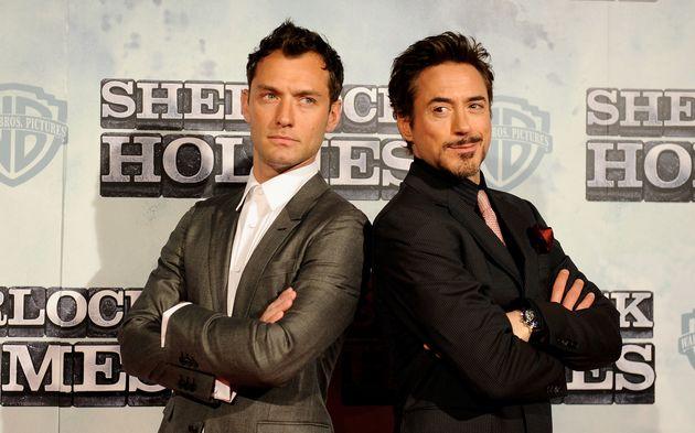 Les acteurs Jude Law (à gauche) et Robert Downey Jr (à droite) lors de la projection du...