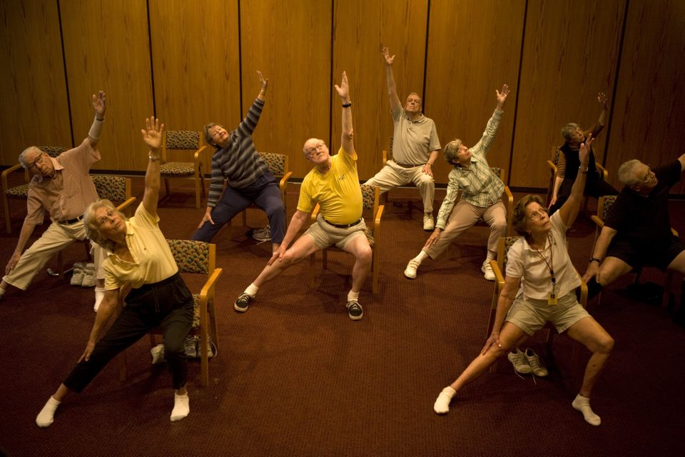 A 'chair yoga' session for residents of John Knox retirement village in Pompano Beach,