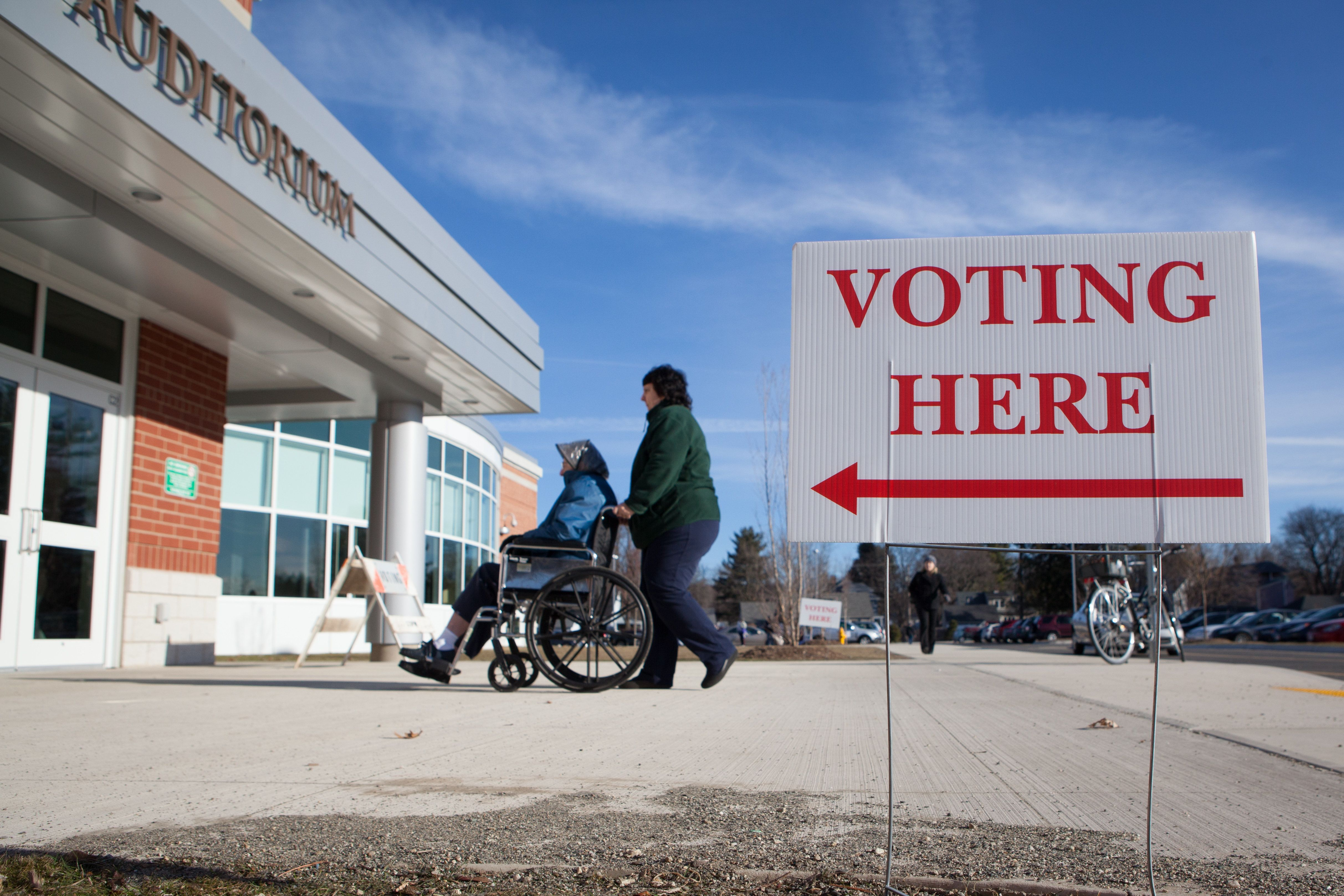 Voters enter a polling place inside Greenfield High School on March 1, 2016 in Greenfield, MA. (Photo by Matthew Cavanaugh/Ge