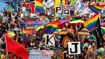 Members of LGBT community wave banners and flags during a Gay Pride parade in Marikina, Metro Manila, in Philippines June 30, 2018. REUTERS/Erik De Castro