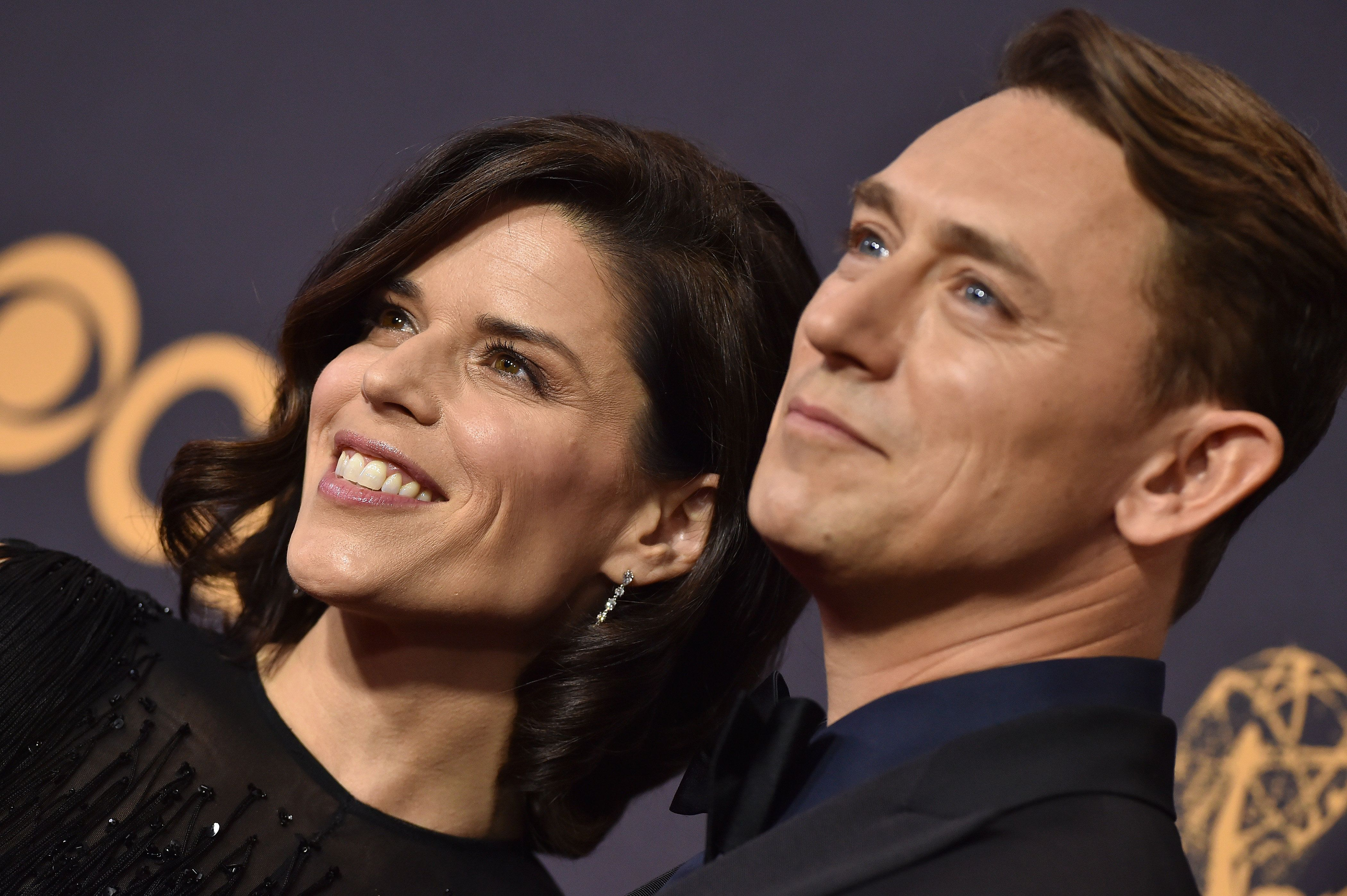 LOS ANGELES, CA - SEPTEMBER 17:  Actress Neve Campbell and JJ Feild arrive at the 69th Annual Primetime Emmy Awards at Microsoft Theater on September 17, 2017 in Los Angeles, California.  (Photo by Axelle/Bauer-Griffin/FilmMagic)