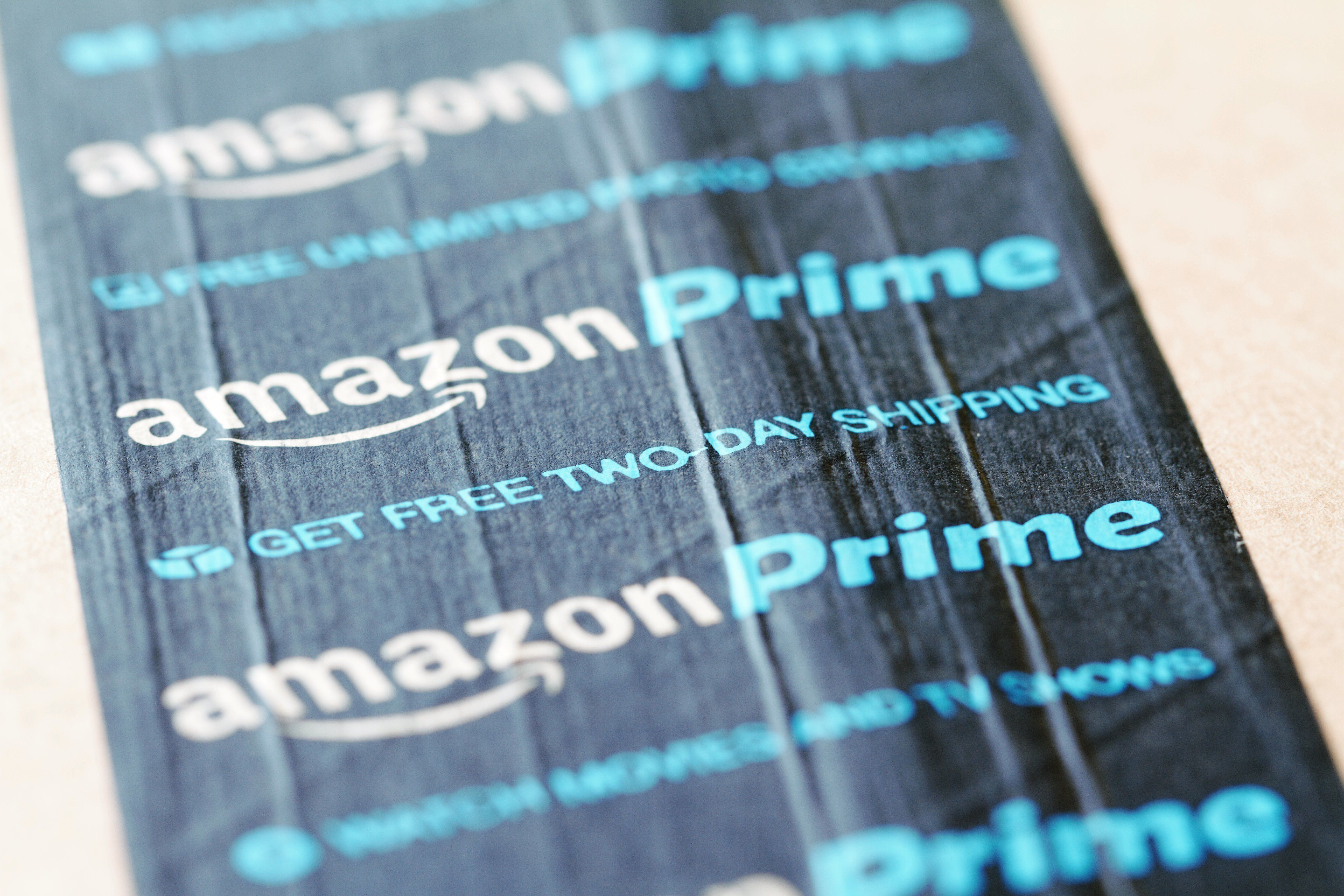 West Palm Beach, USA - June 19, 2016: Amazon Prime packing tape on an Amazon.com shipping box. Amazon Prime is the premium service that provides unlimited  two day shipping, free Cloud storage of photos, video movie streaming and Kindle book downloads.