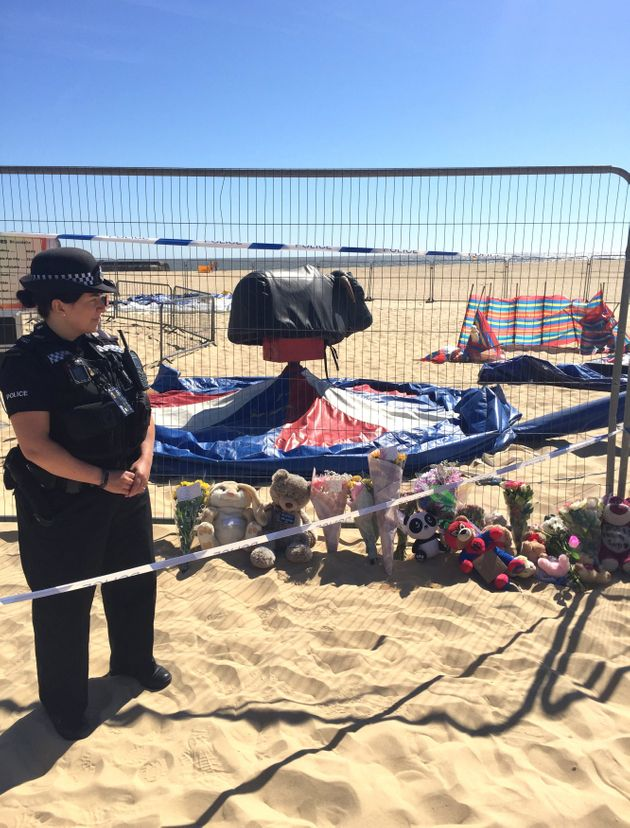 Floral tributes left at Gorleston beach in Norfolk where a girl was fatally thrown from an inflatable on Sunday.