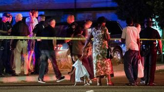 Refugees living in apartments near the corner of State and Wyle streets in Boise, Idaho were reported to be among the nine stabbing victims on Saturday, June 30, 2018. Many families in the area were awaiting information as Boise police investigated the crime scene. The call to police was made at 8:46 p.m. All nine victims were transported to the hospital and police apprehended a suspect at gunpoint soon after the incident. (Darin Oswald/Idaho Statesman/TNS via Getty Images)
