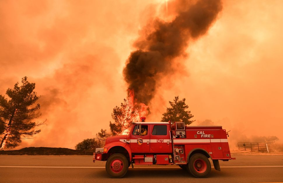 Thousands of firefighters are battling the County fire near Clearlake Oaks, Calif.