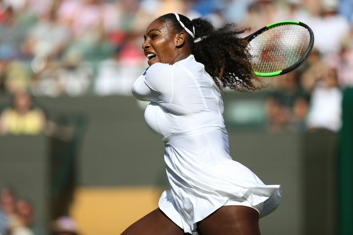 Serena Williams slugs a shot in her victory over Aranxta Rus on Monday at Wimbledon.