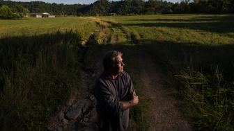 "Mitch Whitaker, 56, stands atop a mountain that cast a shadow where four generations of his family have made a home. It used to be taller, before the coal mines came and removed its top. ""I watched it through my grandpa's eyes when the coal company destroyed it,"" Whitaker said. He would go on to move into a home on 30 acres himself on the same property and with a new federal prison proposed for the site, it feels like deja vu. ""I just never thought this was going to happen again. I thought it would just return back to nature,"" Whitaker said. ""If you look at the other areas surrounding us with prisons and the towns there look the same as they did before."" Whitaker was the only resident with property in the area to oppose the new prison, sold under a banner of economic development at a time where many are out of work in the area. ""It's at the depressed times, at our weakest, we're often taken advantage of,"" Whitaker said. June 27, 2018"