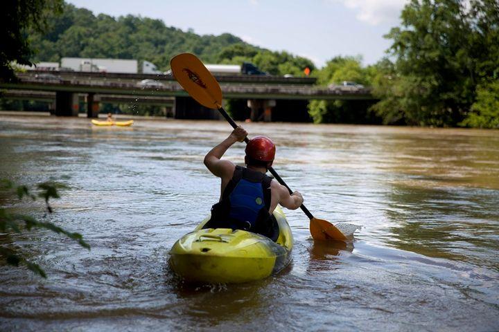 <p>A man kayaks down the Chattahoochee River near Atlanta. </p>