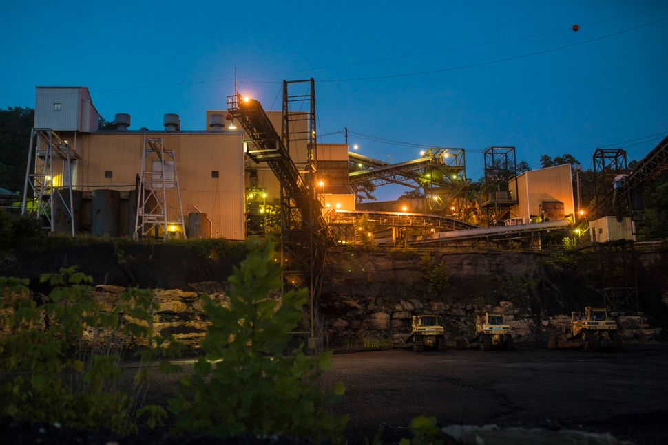 "A coal prep plant, near Whitaker's home, sits in silence during a layoff period. ""It's one of the only"